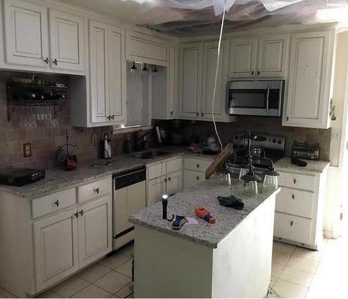same kitchen repaired and as good as new