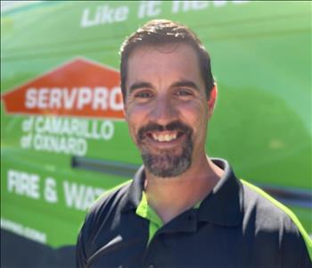 Portrait of male employee Jason in front of green truck