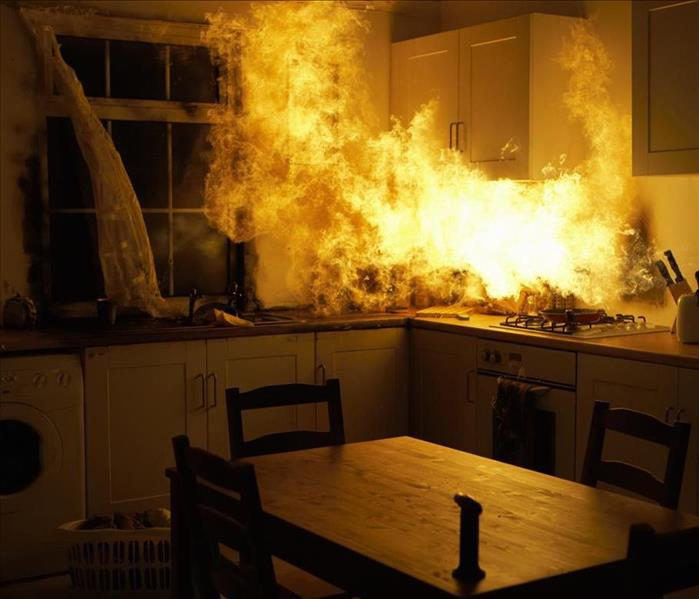 blazing fire in a home kitchen counter area